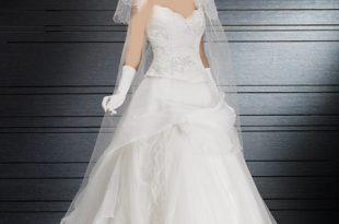 صورة تفسير حلم لبس الفستان الابيض