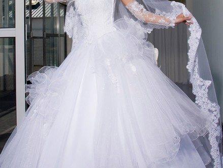 صورة تفسير حلم لبس فستان الزفاف الابيض للعزباء
