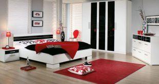 صورة غرف نوم باللون الاحمر والاسود والابيض